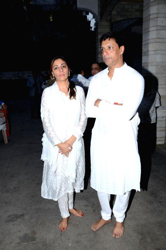Filmmaker Madhur Bhandarkar with wife Renu Namboodiri during the condolence meeting of his mother Shanta Bhandarkar in Mumbai on Feb 23, 2015.