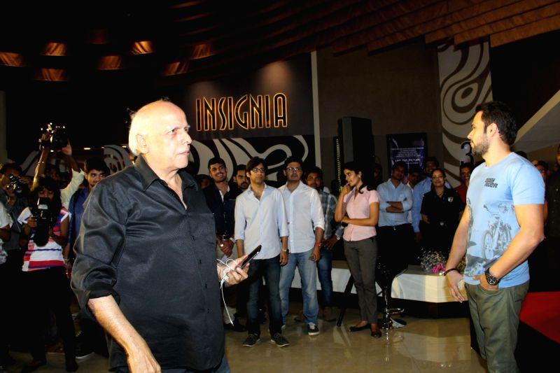 Filmmaker Mahesh Bhatt and actor Emraan Hashmi during the promotion of film Mr X in Mumbai on April 6, 2015. - Mahesh Bhatt