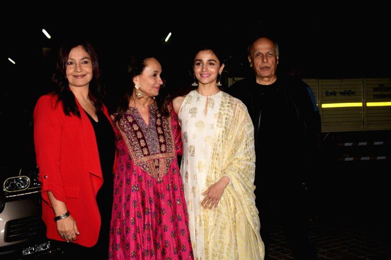 """Mumbai: Filmmaker Mahesh Bhatt with his wife Soni Razdan and children Pooja Bhatt and Alia Bhatt at the screening of upcoming film """"No Fathers in Kashmir"""" in Mumbai, on April 3, 2019."""