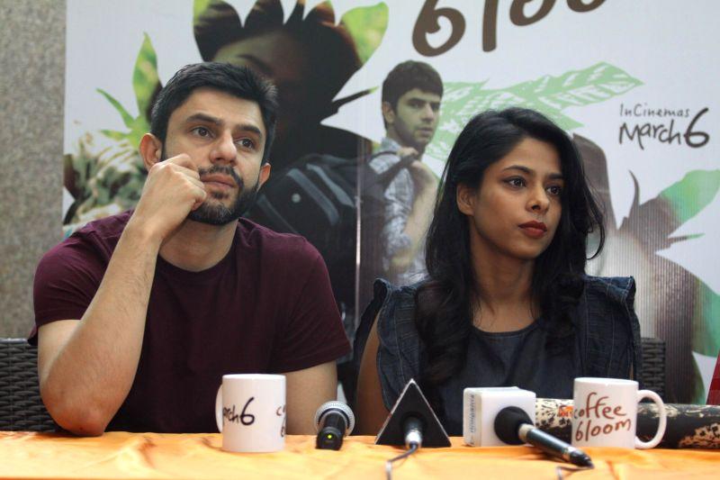 Filmmaker Manu Warrier, actors Arjun Mathur, Sugandha Garg and Mohan Kapoor during a media interaction of film Coffee Bloom in Mumbai on Feb 26, 2015. - Manu Warrier, Arjun Mathur, Sugandha Garg and Mohan Kapoor