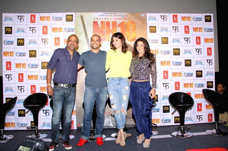 Filmmaker Navdeep Singh, actors Neil Bhoopalam, Anushka Sharma and filmmaker Krishika Lulla during the trailer launch of film NH10 in Mumbai, on Feb 5, 2015. - Navdeep Singh, Neil Bhoopalam and Anushka Sharma