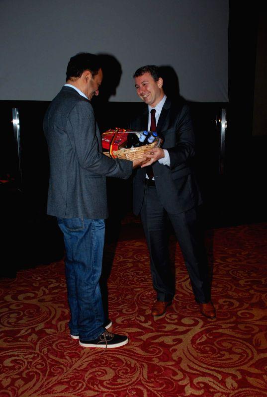 Filmmaker Rajkumar Hirani and Karl Van den Bossche, Consul General of Belgium during presentation of film PK, in Mumbai on Nov 25, 2014. - Rajkumar Hirani