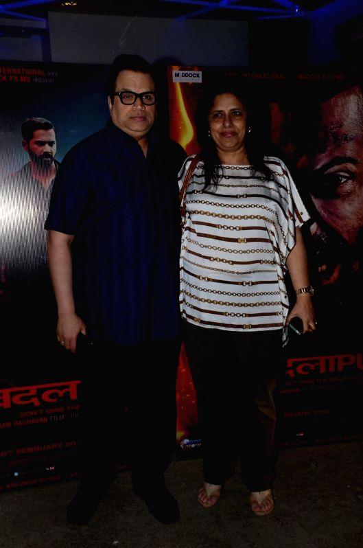 Filmmaker Ramesh Taurani with his wife Varsha during the special screening of the movie Badlapur in Mumbai on 18th Feb, 2015. - Ramesh Taurani