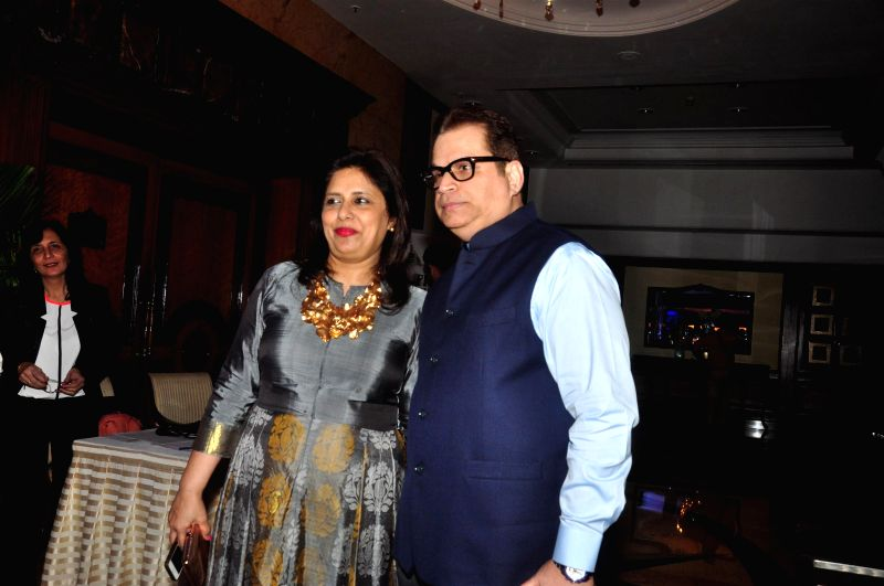 Filmmaker Ramesh Taurani with his wife Varsha during the Anmol Jewellers fashion show `Era of Design`, in Mumbai on April 10, 2015. - Ramesh Taurani