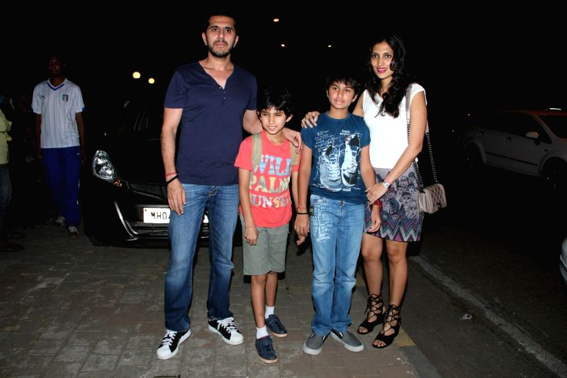 Filmmaker Ritesh Sidhwani with his family leave after attending a get-together at actor Farhan Akhtar`s home, in Mumbai on April 10, 2015. - Ritesh Sidhwani