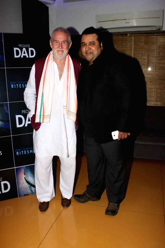 Filmmaker Ritesh Sinha and actor Tom Alter during the trailer launch of international film Promise Dad in Mumbai, on April 23, 2015. - Ritesh Sinha