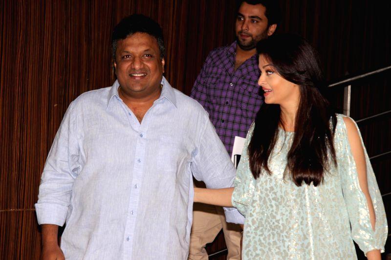Filmmaker Sanjay Gupta and actor Aishwarya Rai Bachchan during the script reading session of film Jazbaa in Mumbai, on Jan 13, 2015. - Sanjay Gupta and Aishwarya Rai Bachchan