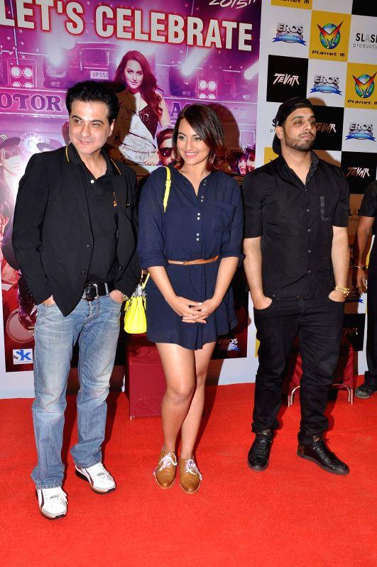Filmmaker Sanjay Kapoor and actor Sonakshi Sinha during the promotion of film Tevar in Mumbai, on Dec. 20, 2014. - Sanjay Kapoor and Sonakshi Sinha