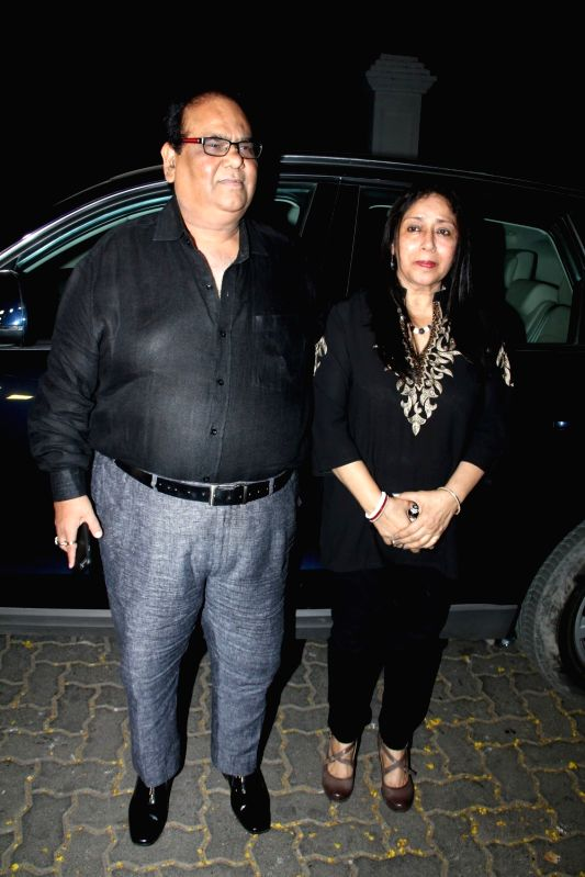 Filmmaker Satish Kaushik and his wife arrive for actor Anil Kapoor`s get-together to share the trailer of the film Dil Dhadakne Do, in Mumbai on 13th April 2015. - Satish Kaushik