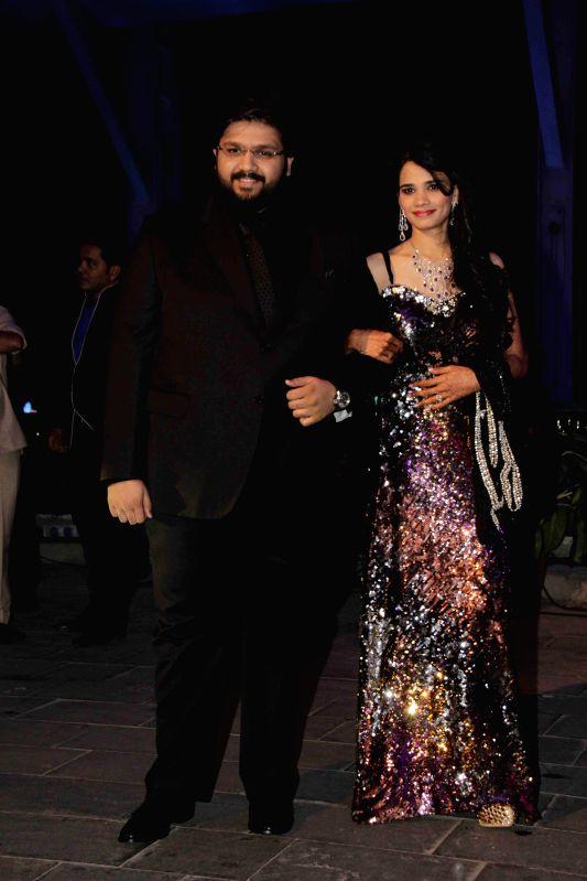 Filmmaker Smita Thackeray`s son Rahul Thackeray and Dr. Aditi Thackeray during the wedding reception of Bollywood filmmaker Smita Thackeray`s son Rahul Thackeray and Dr. Aditi Thackeray in ...