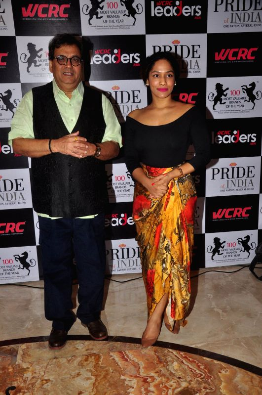 Filmmaker Subhash Ghai and fashion designer Masaba during Pride of India Awards in Mumbai, on Dec. 16, 2014. - Subhash Ghai