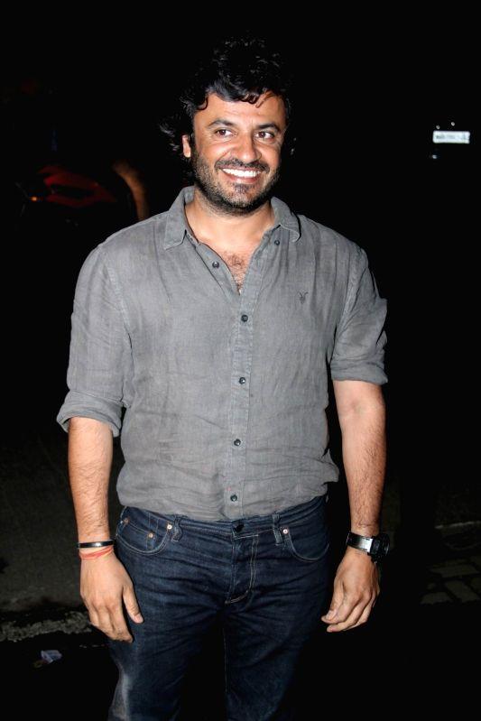 Filmmaker Vishal Bahl leaves after attending a get-together at actor Farhan Akhtar`s home, in Mumbai on April 10, 2015. - Vishal Bahl