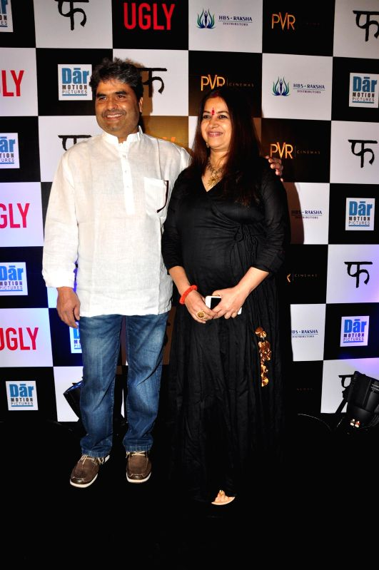 Filmmaker Vishal Bhardwaj with his wife during the premiere of film Ugly in Mumbai on 23, Dec. 2014. - Vishal Bhardwaj