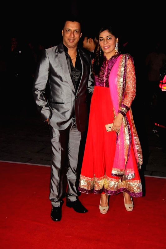 FilmmakerMadhur Bhandarkar with wife Renu Namboodiri during Shatrugan Sinha's son Kush wedding reception in Mumbai, on Jan. 19, 2015. - Shatrugan Sinha