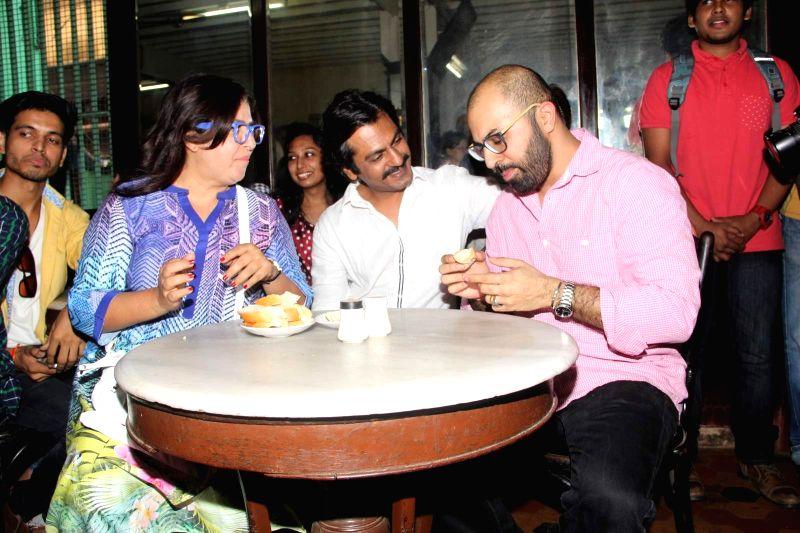 Filmmakers Farah Khan, Ritesh Batra and actor Nawazuddin Siddiqui during the launch of Ritesh Batra`s `Poetic License` at Irani Cafe, in Mumbai on April 4, 2015. - Nawazuddin Siddiqui and Farah Khan