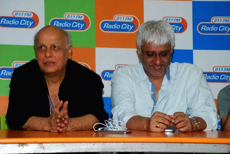 Filmmakers Mahesh Bhatt and Vikram Bhatt during the music launch of film Mr. X at Radio City in Mumbai, on March 13, 2015. - Mahesh Bhatt and Vikram Bhatt