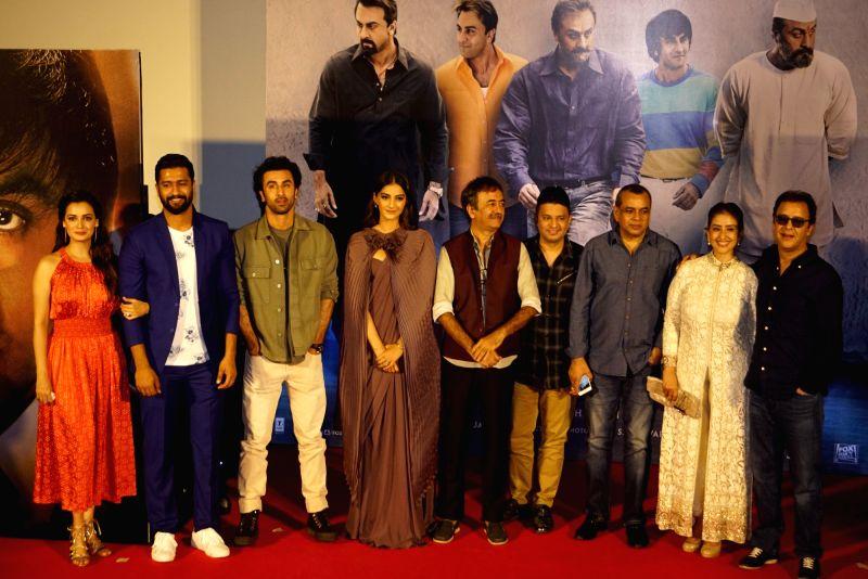 :Mumbai: Filmmakers Rajkumar Hirani and Vidhu Vinod Chopra with actors Diya Mirza, Vicky Kaushal, Ranbir Kapoor, Sonam Kapoor, Paresh Rawal and Manisha Koirala and T-Series MD Bhushan Kumar at the ...