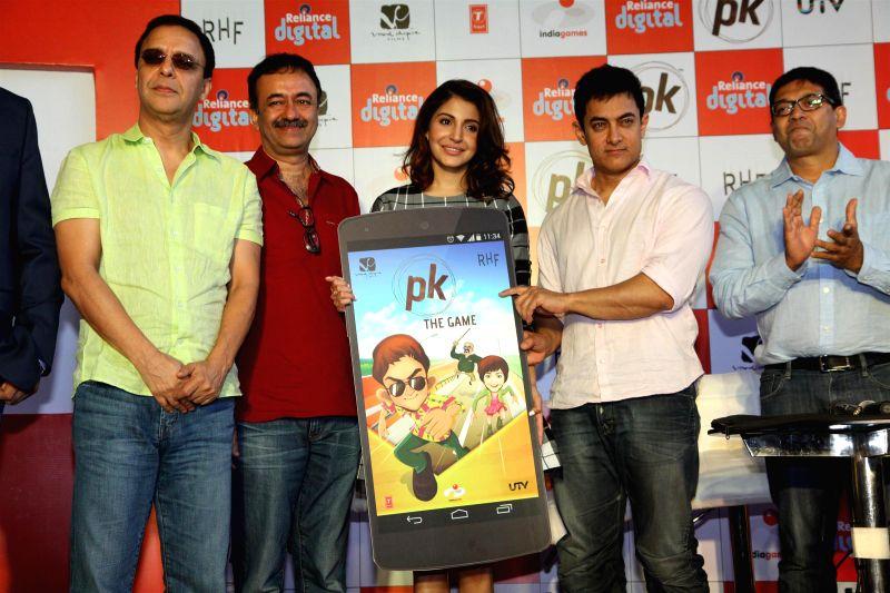 Filmmakers Vidhu Vinod Chopra and Raju Hirani, actors Anushka Sharma and Aamir Khan during the launch of official mobile game PK, in Mumbai on Dec. 12, 2014. - Vidhu Vinod Chopra, Raju Hirani, Anushka Sharma and Aamir Khan
