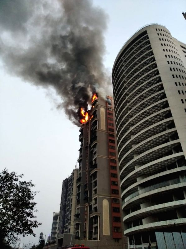 Mumbai: Fire breaks out at a high-rise apartment building at Sector 44, Nerul Seawoods in Navi Mumbai on Feb 8, 2020.
