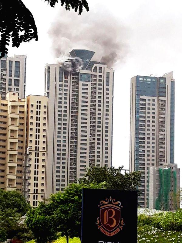 :Mumbai: Fire breaks out at a Mumbai high-rise on June 13, 2018. (Photo: IANS).