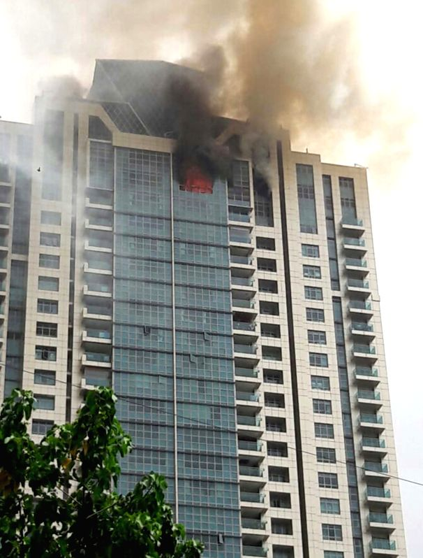 : Mumbai: Fire breaks out at Beaumonte Towers in Prabhadevi of Mumbai on June 13, 2018. At least 90 residents were evacuated safely. According to officials, the fire was seen around 2.10 pm on the ...