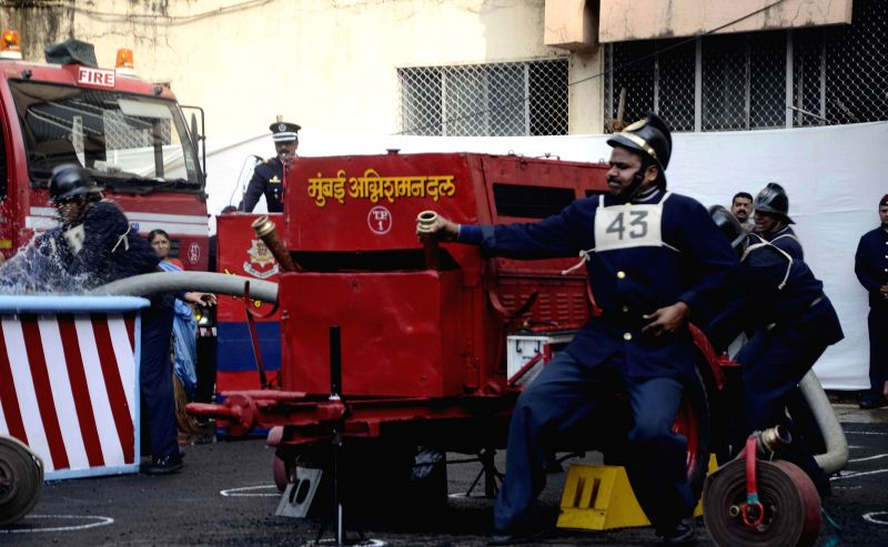 Fire Brigade personnel during a mock drill being conducted at Fire Brigade Head Quarter, Byculla in Mumbai on Dec 13, 2014.