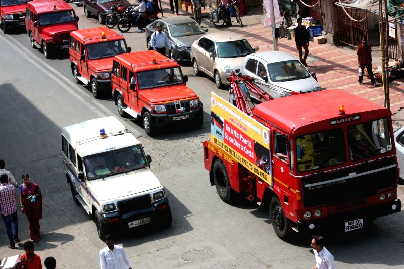 Fire fighters participate in a rally organised by the Fire Brigade during Fire Service Week - April 14 - 20 - in Mumbai, on April 19, 2015.