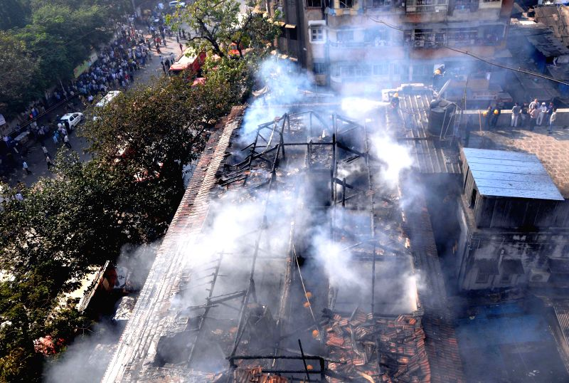 Firefighters try hard to douse a fire that broke out at Noor Manzil of Byculla, Mumbai on Feb 6, 2015.