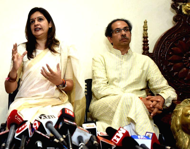 Mumbai: Former Congress spokesperson Priyanka Chaturvedi accompanied by Shiv Sena chief Uddhav Thackeray, addresses a press conference after joining Shiv Sena, in Mumbai on April 19, 2019.