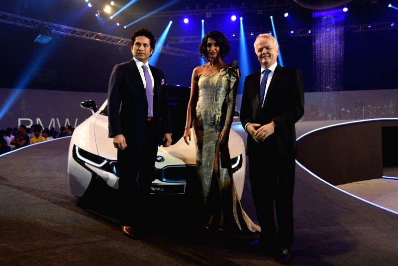 Former Indian cricketer Sachin Tendulkar launches the new 2015 BMW i8 hybrid sports car in Mumbai on 18th Feb, 2015.