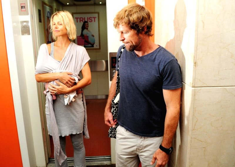 Former South Africa cricketer Jonty Rhodes and his girlfriend Melanie with their baby at Surya Mother and Child Care Hospital in Mumbai, on April 24, 2015. The girl has been named India.