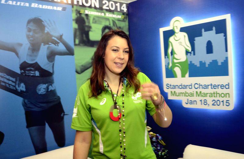 Former tennis player of France Marion Bartoli during a press conference regarding Mumbai Marathon 2015 in Mumbai, on Jan 15, 2015.