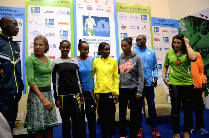 Former tennis player of France Marion Bartoli with other athletes during a press conference regarding Mumbai Marathon 2015 in Mumbai, on Jan 15, 2015.