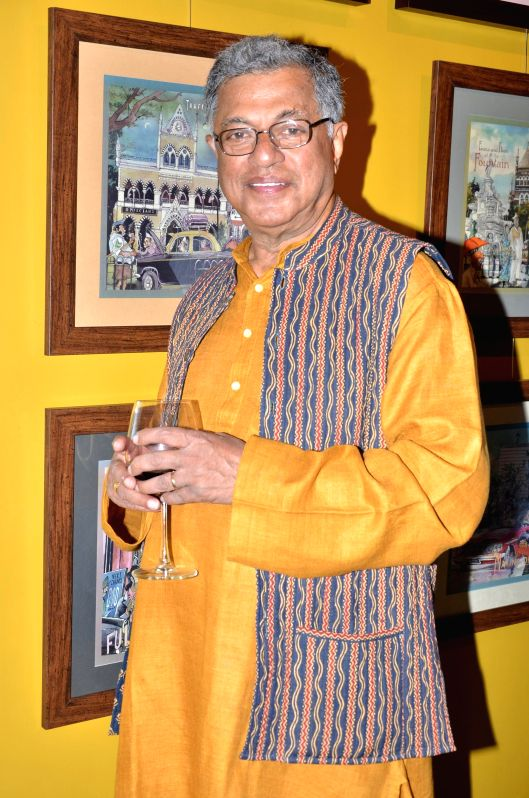 Girish Karnad during opening of a cartoon gallery ``aPaulogy`` by Paul Fernandes in Mumbai on Dec 13, 2014.