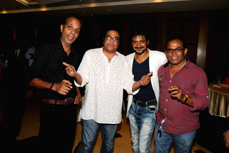Gopal Singh, Zakir Hussain, Subrat Datta and Harish Hariodh during the film Bumper Draw completion party in Mumbai on April 26, 2015. - Gopal Singh