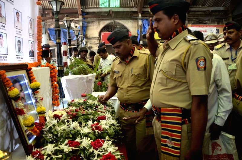 Government Railway Police (GRP) personnel pay tribute to those killed in the 26/11 attacks on Chhatrapati Shivaji Terminus railway station on the 6th anniversary of the attacks, at ...