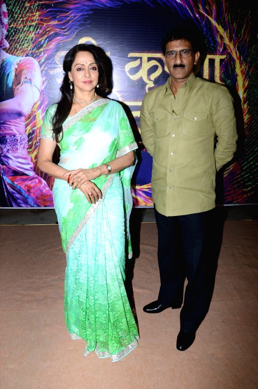 Hema Malini & Sunil Rane during the press conference to announce a two - day long Braj Mahotsav at Mathura, Vrindavan Chandrodaya Mandir on April 25 and 26 in Mumbai on April 21, 2015. - Hema Malini