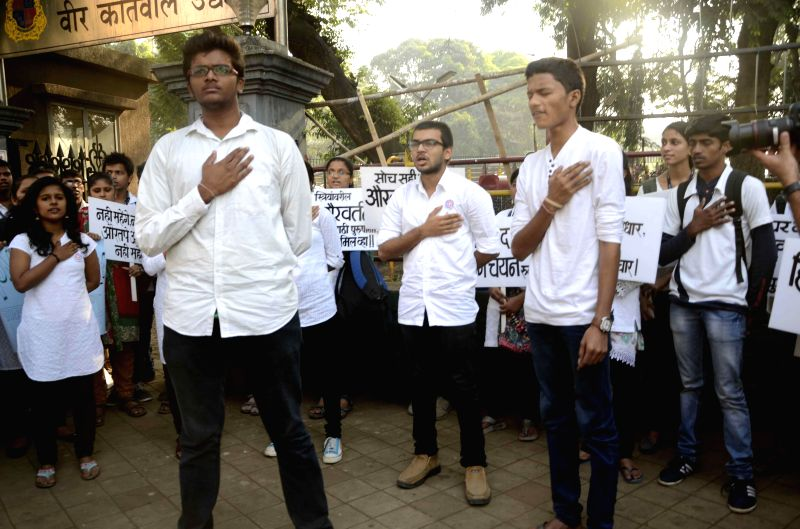 Human Rights activists stage a street play on Human Rights Day in Mumbai, on Dec 10, 2014.
