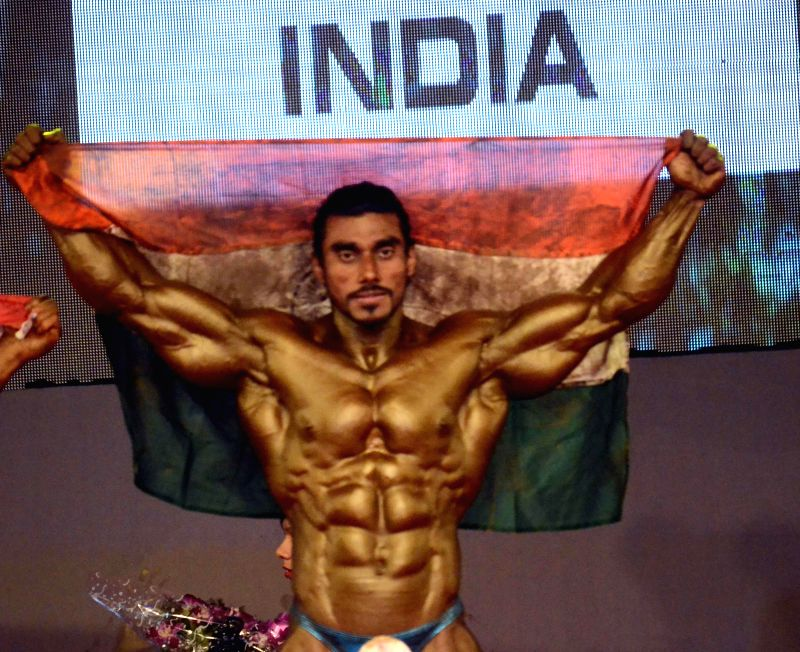 Indian bodybuilder Sumit Chaudhari who won gold during the 6th World Bodybuilding and Physique Sports Championship 2014 at Goregaon in Mumbai on Dec 9, 2014.