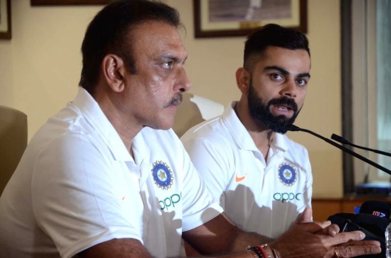 Mumbai: Indian cricket team's head coach Ravi Shastri and skipper Virat Kohli address a press conference ahead of leaving for England to participate in the ICC Cricket World Cup 2019, in Mumbai on May 21, 2019.