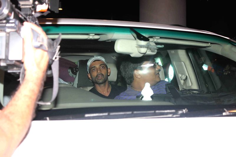 Indian cricketer Ajinkya Rahane arrives from Australia at the Chhatrapati Shivaji International Airport, in Mumbai on March 27, 2015.
