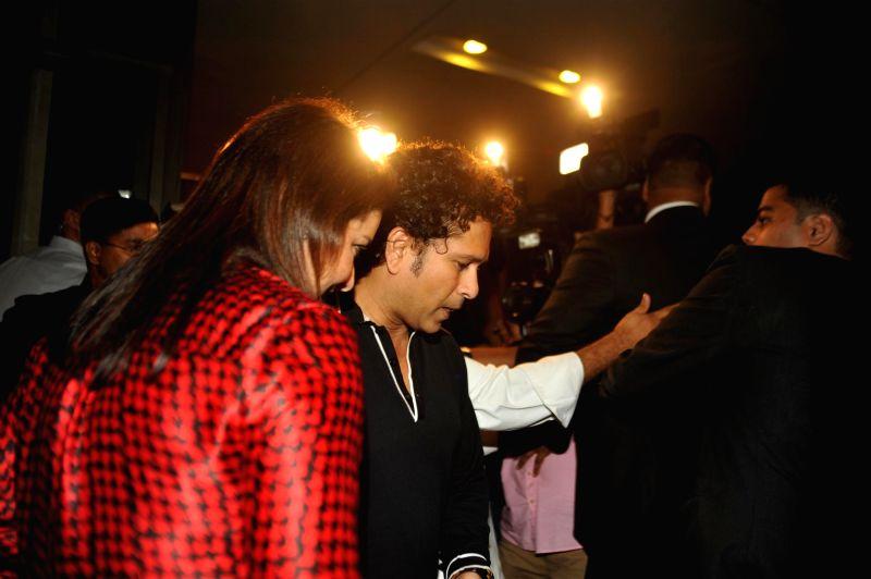 Indian cricketer Sachin Tendulkar along with his wife Anjali Tendulkar arrives for felicitation ceremony of cricketer Rohit Sharma who hit a world-record double century in Mumbai, on November - Sachin Tendulkar