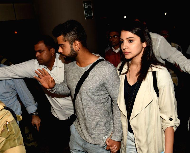 Indian cricketer Virat Kohli and Bollywood actress Anushka Sharma arrive from Australia with the Indian cricket team, at the Chhatrapati Shivaji International Airport, in Mumbai on March 27, ...