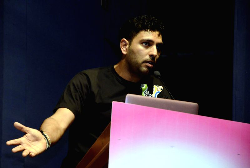 Indian cricketer Yuvraj Singh addresses during a cancer awareness programme in Mumbai, on March 8, 2015.