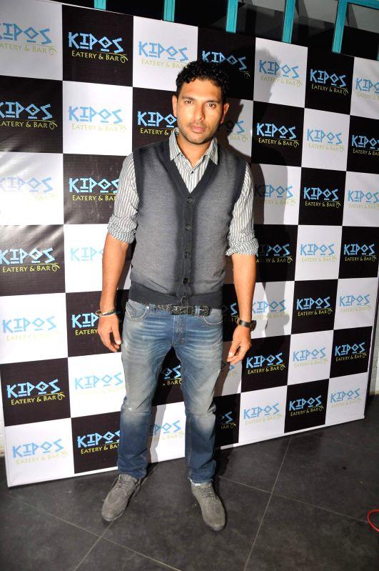 Indian Cricketer Yuvraj Singh at at Kipos greek restaurant launch in Mumbai on on Nov 28, 2014. - Cricketer Yuvraj Singh