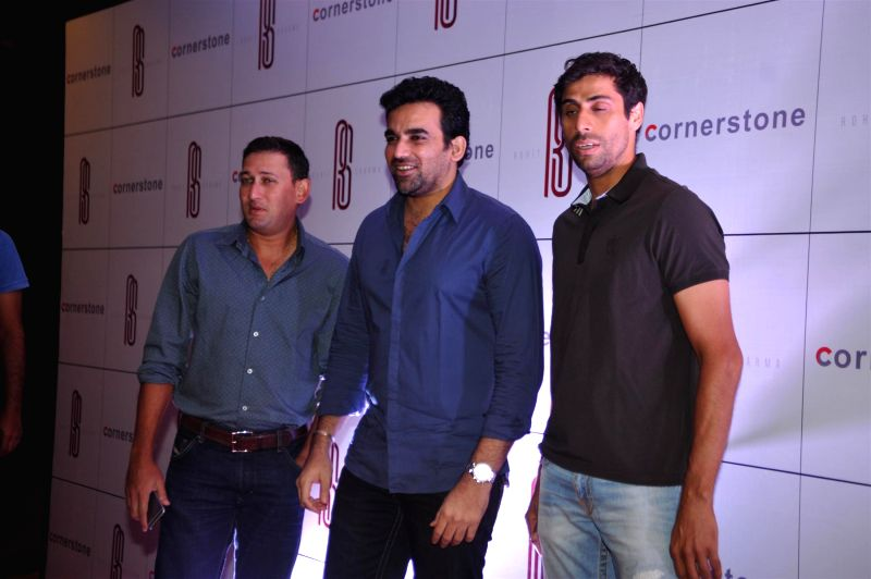 Indian cricketers Ajit Agarkar, Zaheer Khan and Ashish Nehra arrives for felicitation ceremony of cricketer Rohit Sharma who hit a world-record double century in Mumbai, on November 20, 2014. - Ashish Nehra and Zaheer Khan