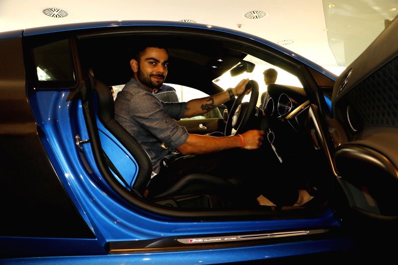Indian player Virat Kohli with his new limited edition of Audi R8    Virat Kohli With His Audi R8