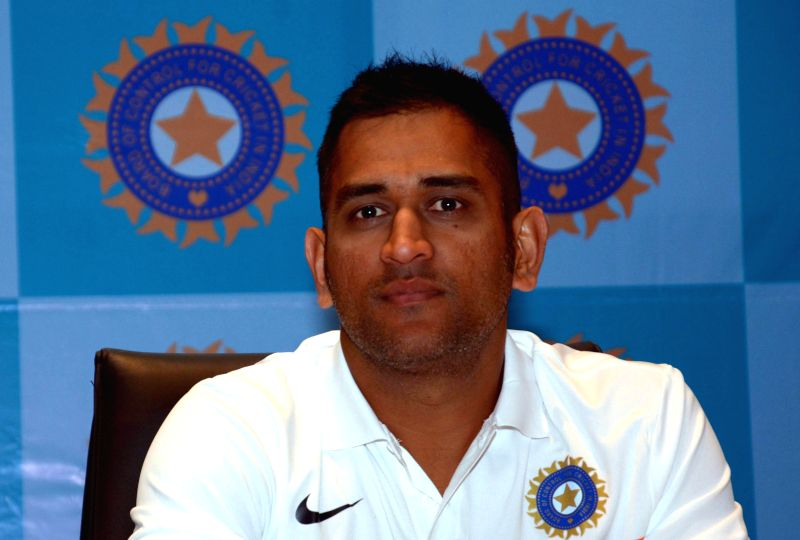 Indian skipper Mahendra Singh Dhoni Tuesday decided to retire from Test cricket citing the strain of playing all three formats of the game after India drew the third Test against Australia. .. - Mahendra Singh Dhoni and Virat Kohli