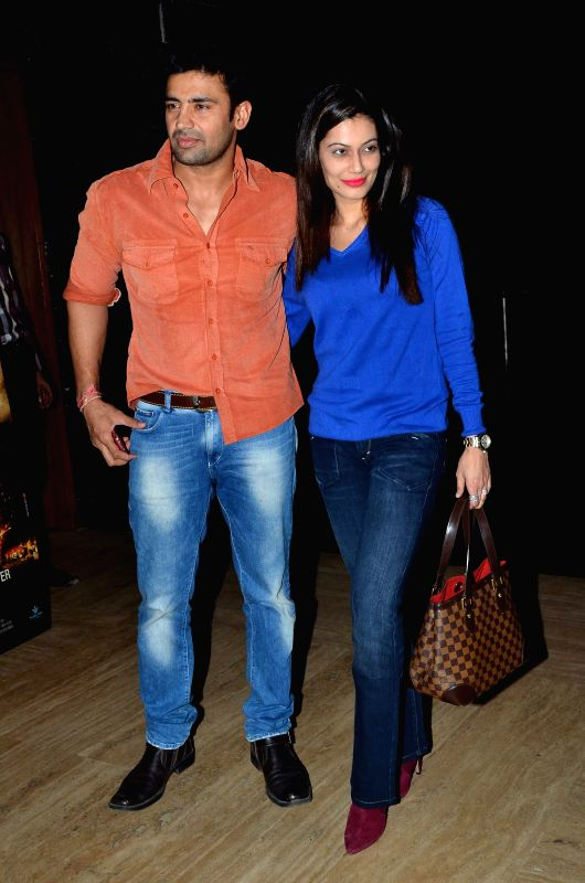 Indian wrestler Sangram Singh along with his wife and actor Payal Rohatgi during the premiere of film Bhopal: A Prayer for Rain in Mumbai, on December 4, 2014. - Payal Rohatgi and Sangram Singh