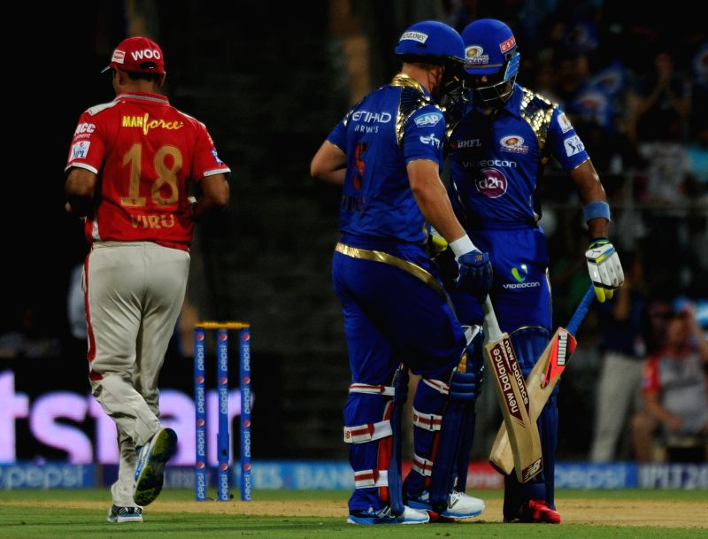 Mumbai Indians batsmen Aditya Tare and Aron Finch during an IPL-2015 match between Mumbai Indians and Kings XI Punjab at Wankhede Stadium, in Mumbai, on April 12, 2015.